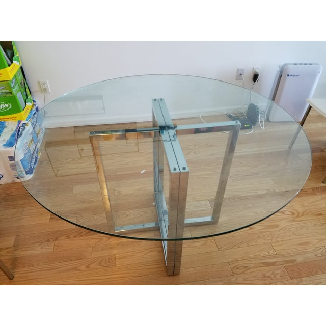 """Two sleek chrome modern """"sawhorses"""" partner with crisp, clean clear glass tops, round or rectangle—your choice. Offers..."""