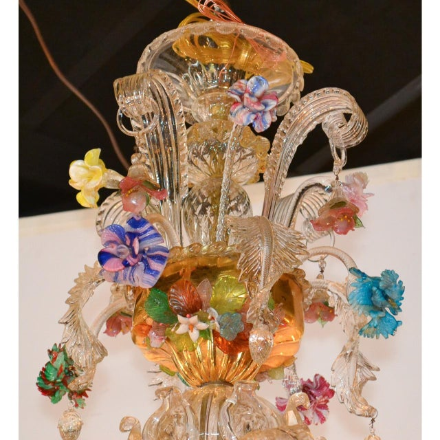 Fabulous antique Venetian blown glass and gilt brass twelve-light chandelier featuring and extraordinary array of colorful...