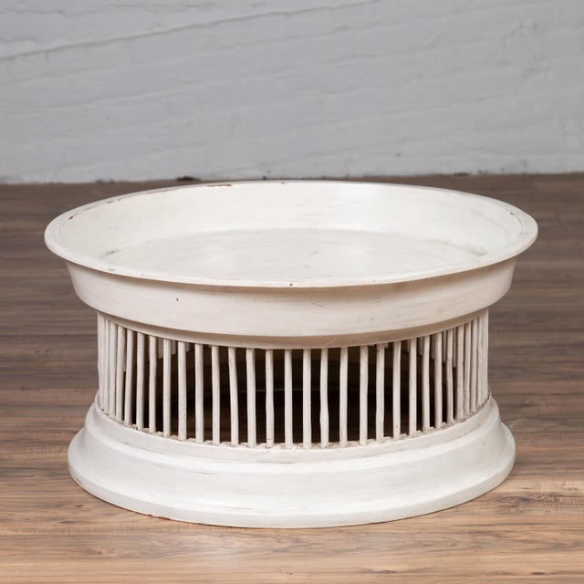 A contemporary Thai off-white painted rattan coffee table with drum design. We have more tables available with slight...