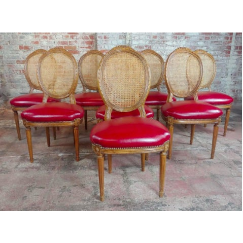 Beautiful set of Louis cane backed dining chairs with red leather seats. Purchased on Chairish for a project that was...