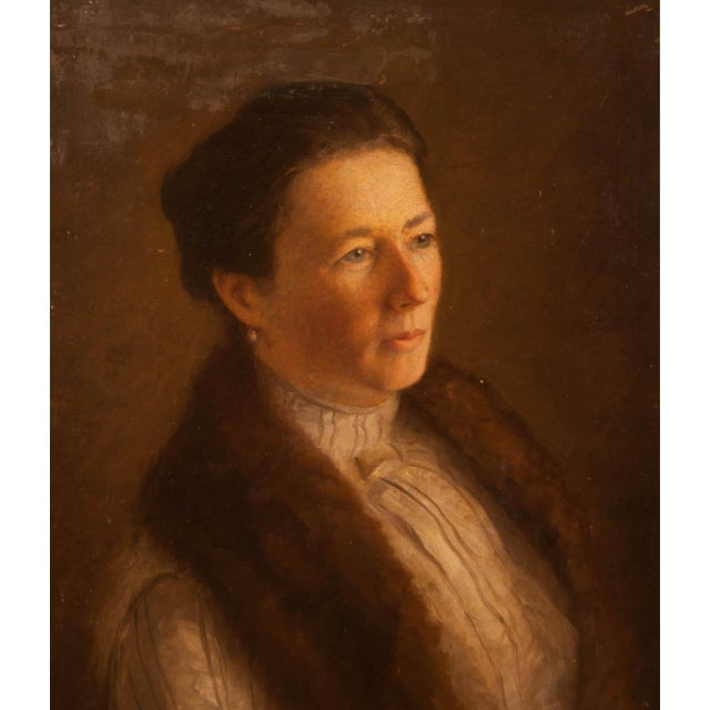 An atmospheric painting of a woman wearing clothing fashionable around 1900. We believe the painting is American and love...
