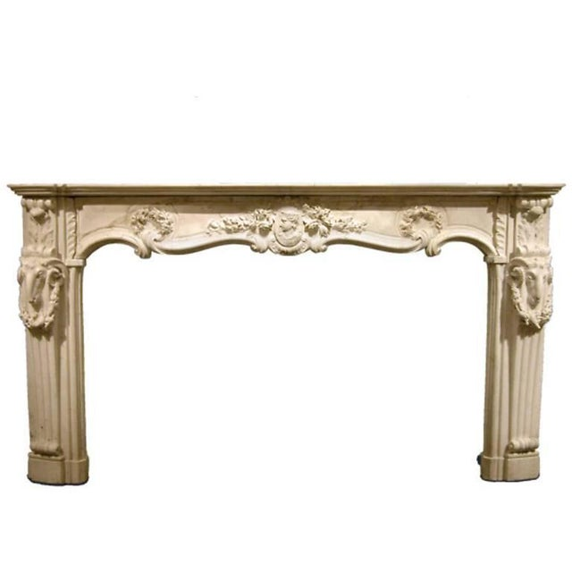 This rare and monumental marble fireplace mantel is crafted from the finest Carrara marble. A masterpiece of Georgian...