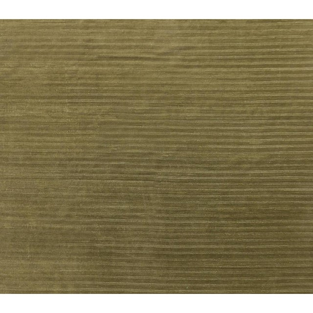 A wonderful hand knotted wool a rug with a soft sheen in a shades of olive green.