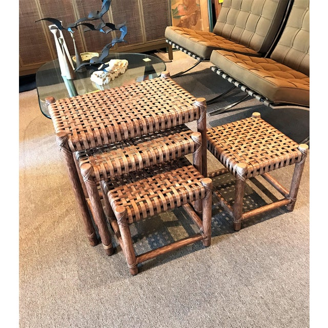 Four McGuire Company of San Francisco, CA Leather-Laced Nesting Tables or Stools. The leather is quite sturdy and has a...