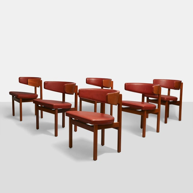 A set of dining or conference Chairs by Borge Mogensen for Fredericia Furniture, Model #3245. Mahogany frames and Ox-Blood...