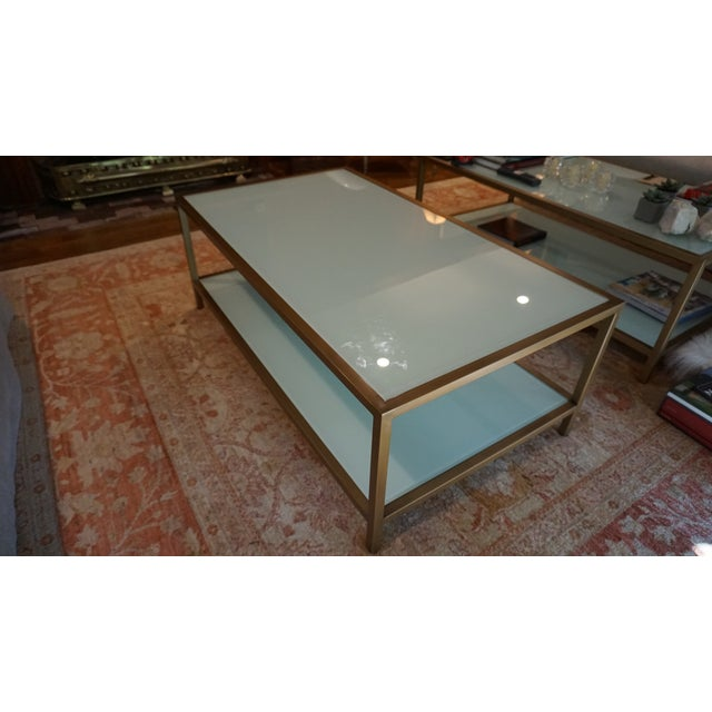 Suzanne Kasler coffee table with bottom shelf - features panels of white glass defined with crisp modern lines finished in...