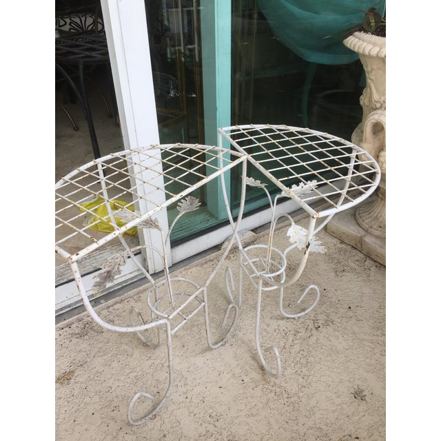"""Pair of outdoor steel mesh end tables. Use separately or combine for a nice round table. Each is 8.5"""" deep for 15"""" total."""