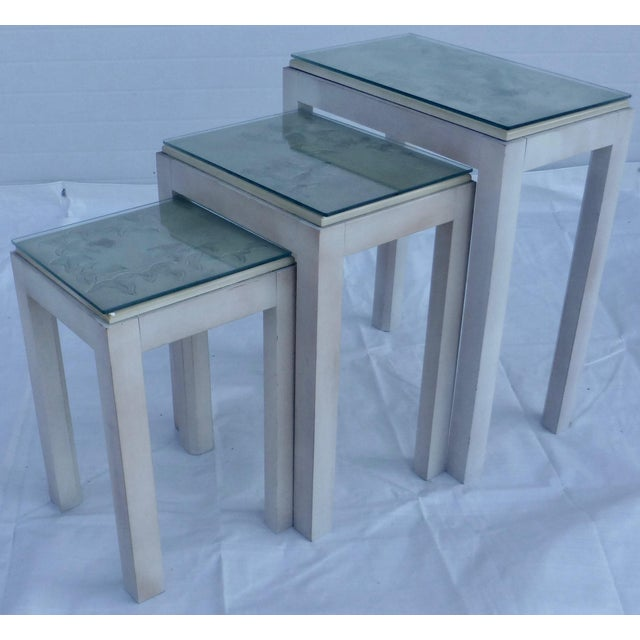 Dating circa 1980, this is a pretty set of three nesting tables. We love the floral design to the tile tops! So organic!...