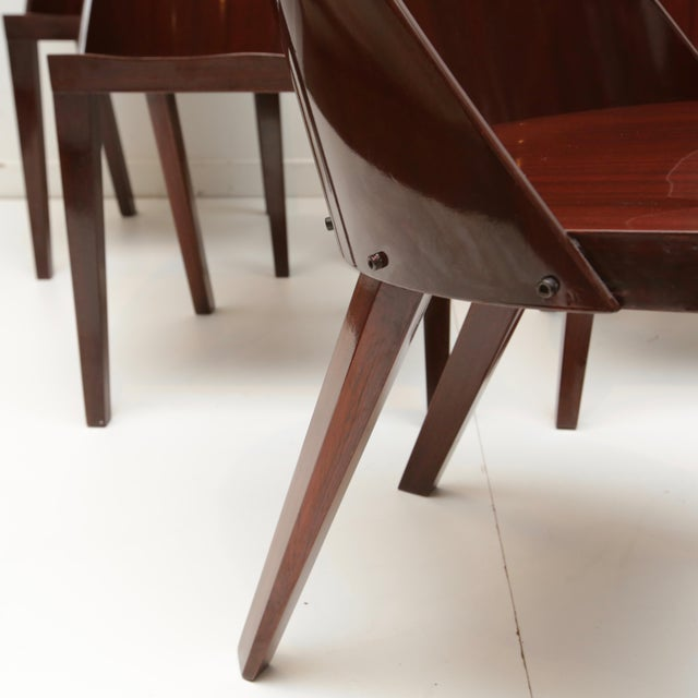 Set of six mahogany veneer chairs designed by Starck for the Royalton Hotel.