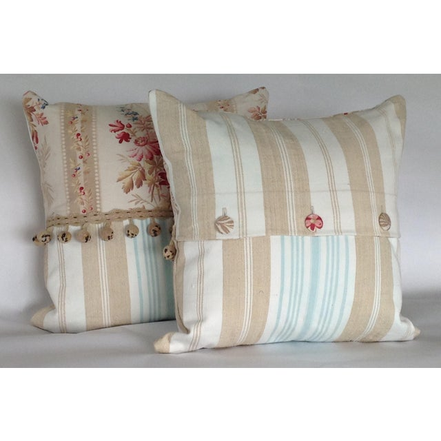 Early 20th Century 19th Century French Floral & Linen Ticking Stripe Pillows With Pom-Poms - a Pair For Sale - Image 5 of 7