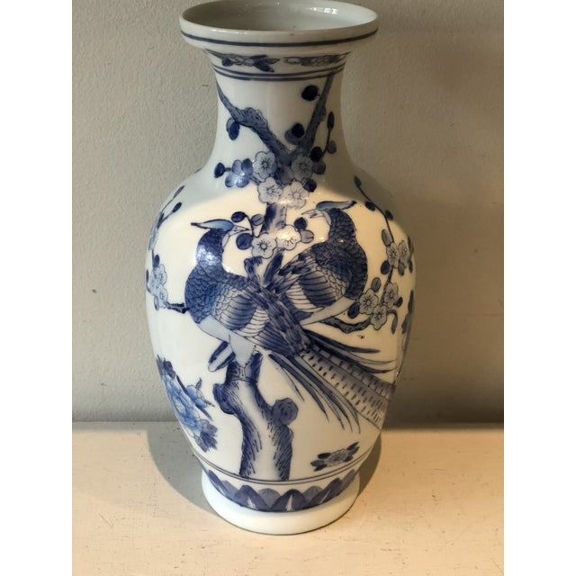 Exquisite hand painted blue and white botanical motif Japanese jar.