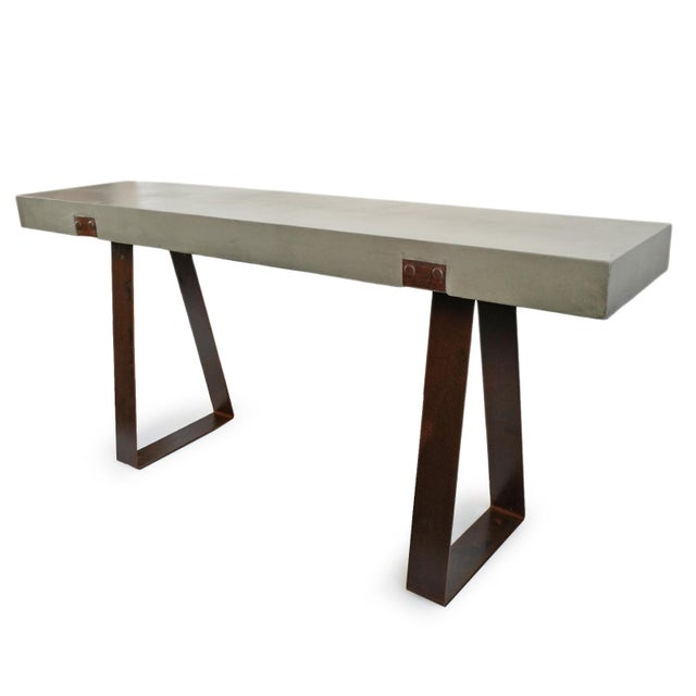 Outdoor console table with cement top and industrial aged iron base. Simple modern design. Great for use indoors or...