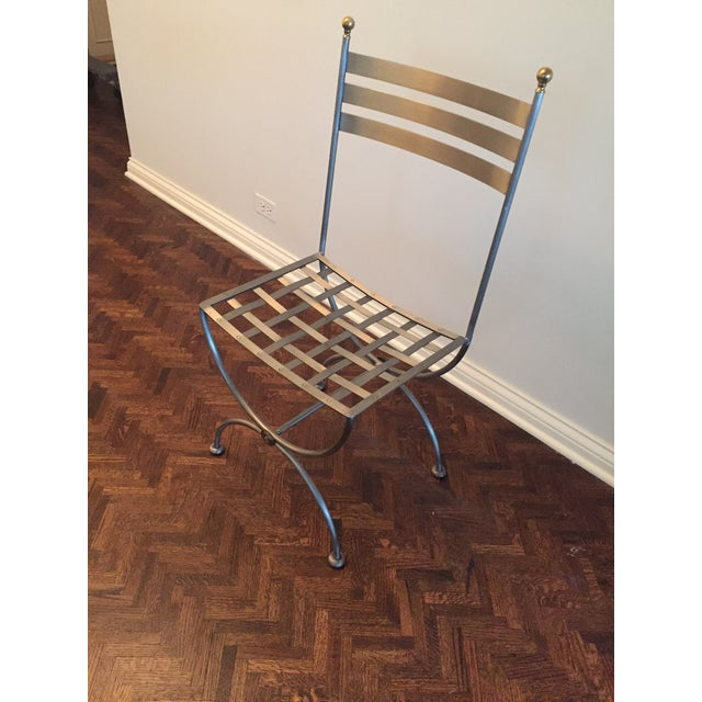 Lovely accent to any room or sunroom. Brass and iron side chair, currently used with custom cushion as a kitchen office...