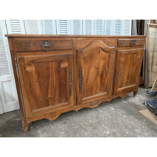 Stunning solid cherrywood buffet with three cabinets and two single draws above outer cabinets. Resting upon square...