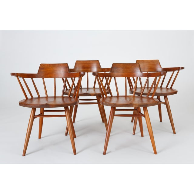 An accomplished example from American Mid Century craftsman George Nakashima. The black walnut Captain Chair has a curved,...
