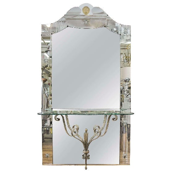 Dramatic 1930s Hollywood Regency Italian Mirror with Stunning Console shelf. The Mirror has a Gold Accented Scallop Shell...