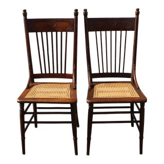 Late 19th Century Oak Pressed Back Spindle Cane Seat Dining Chairs - a Pair For Sale