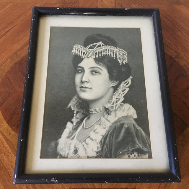 A fabulous vintage black and white photo of a lady dressed in a traditional manner and covered in jewels.