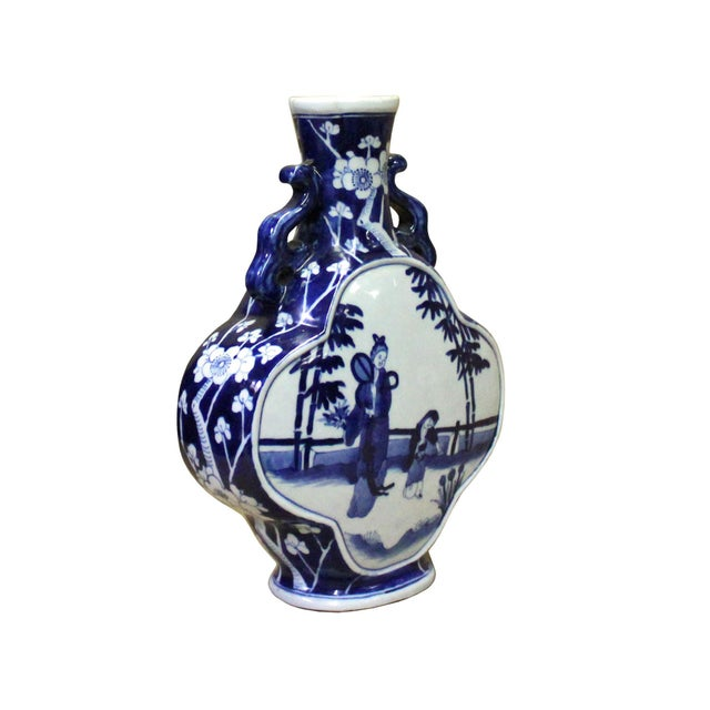 This is a Chinese decorative porcelain vase in Blue and White color finish. The theme is oriental people scenery graphic....