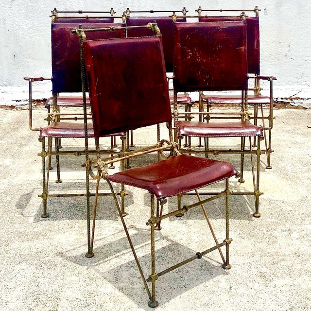 Striking vintage set of 6 Brutalist Dining chairs. Made in the manner of Ilana Goor. Heavy distressed rebar sculpted into...
