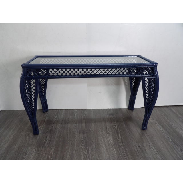 Bold navy lacquer is the new finish on this unique Bamboo and Rattan Console. The console is glass topped with ornate...