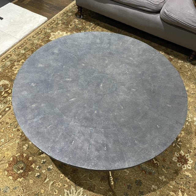 Round Century Furniture Grand Tour coffee table designed by Pride Sasser. Brass legs with paw feet and shagreen style top....