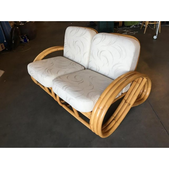 Mid-Century three-strand 3/4 round pretzel-style, two-seat sectional loveseat. This sofa features the rare round half...