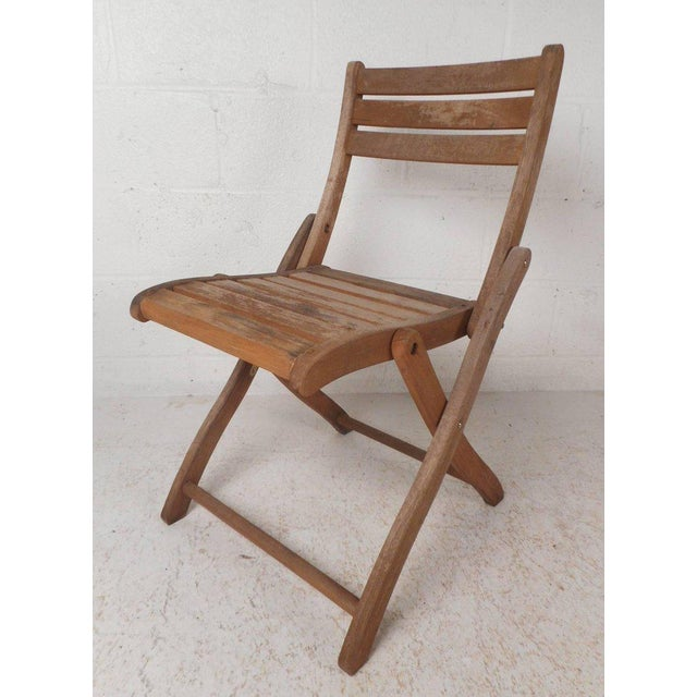 """This beautiful set of five vintage modern folding chairs feature a stylish """"X"""" shape base. Sleek and sturdy design with..."""