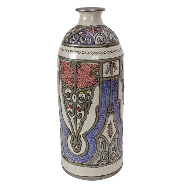 Handcrafted by artisans in Fez, this traditional jar has been hardened in the sun, then fired three times in its creation...