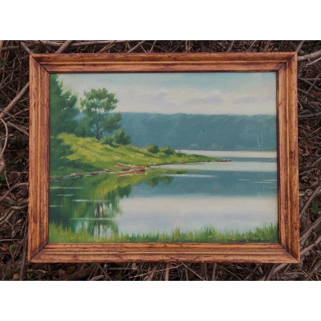 """An oil painting titled """"A Lake in the Berkshires"""" signed by the American artist J. Campbell Phillips (1873 - 1949). Known..."""