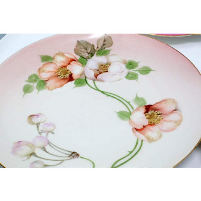 A set of antique 1930's-40's salad plates, including hand-painted and numbered Bavarian China. Each plate is decorated...