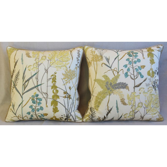 Pair of custom-tailored pillows in vintage cotton fabric with a wildflower, floral and butterfly motif. Vintage sand...