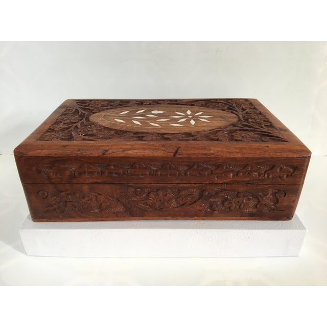 Beautiful rectangular hand carved wooden box from India. This vintage box is hand carved in a floral motif that is on the...