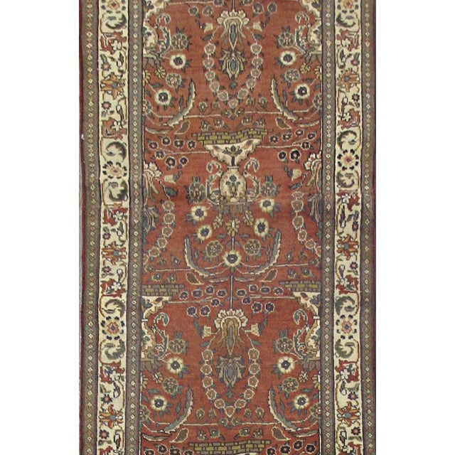 This beautiful rug is hand made, made in Iran. It features a pattern in a vibrant combination of red, rust,...