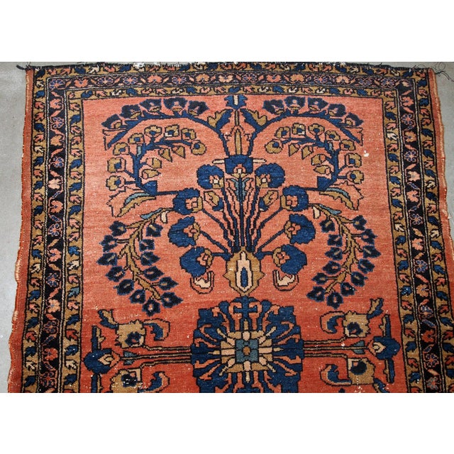 Handmade antique Persian Lilihan rug in red colour. The rug is from the beginning of 20th century in original condition,...