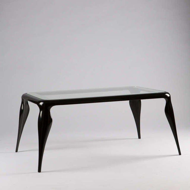 Sinuous wood coffee table by Pietro Chiesa for Fontana Arte. Perfect frame and wood surface with mirrored stripe all-over...