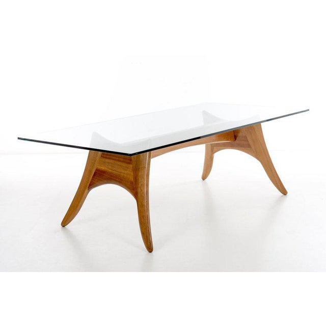 Dining table dramatic splayed legs crafted from oakwood with great technical joinery. Seats six to eight. Can also be used...