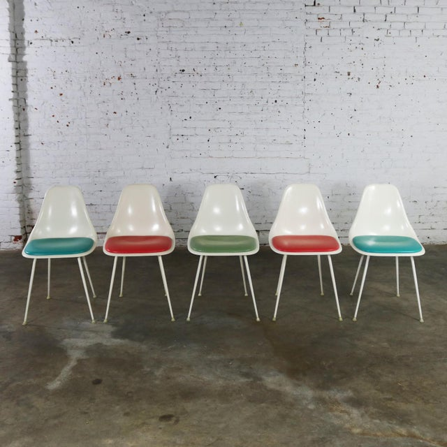 Awesome set of five mid-century modern Burke #103 fiberglass shell side chairs with multicolored vinyl padded seats in...
