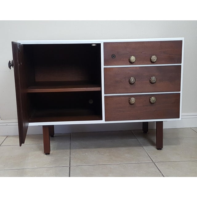 Solid and great looking mid-century cabinet by one of the period's foremost designer. This is a hard-to-find small sized...