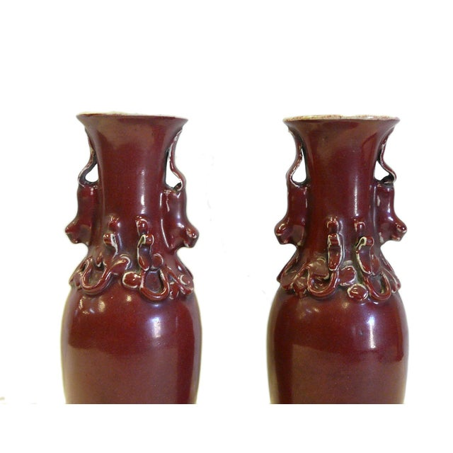 This is a pair of old handmade ceramic vase with crackle pattern inside and ancient Chinese Pixiu mythical animal pattern...