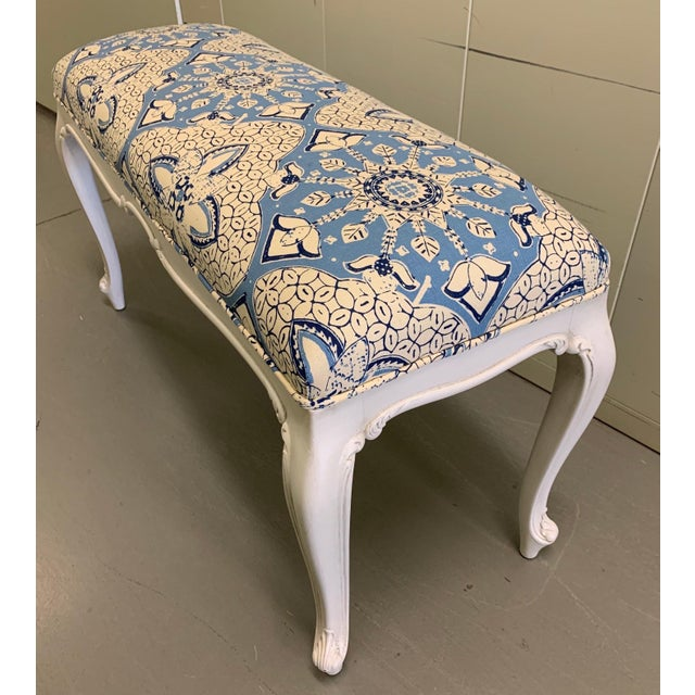 1940s French style carved wood bench. Newly repainted in antique white finish. Newly upholstered in Quadrille 'New Batik'...