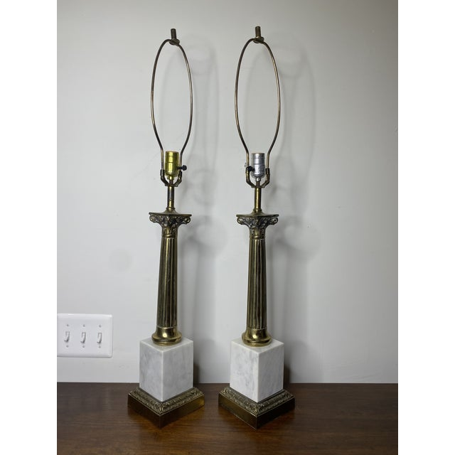 Handsome pair of Carrara marble and solid cast brass neoclassic column lamps. Height given is to top of light socket...