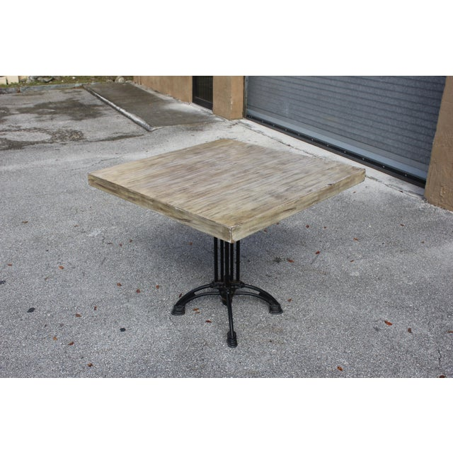 French Country cast iron base walnut top dining table or bistro table. Perfect for 2 - 4 person dining, the cast iron base...