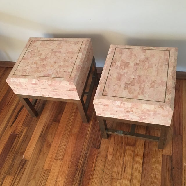 Pink tessellated marble, brass inlay, on brass stands. Essentially these are very large boxes that rest on brass legs. Can...