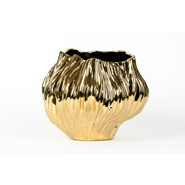 Midcentury gold ceramic vase with organic shape and textured surface. This piece is exquisite and would bring a great...