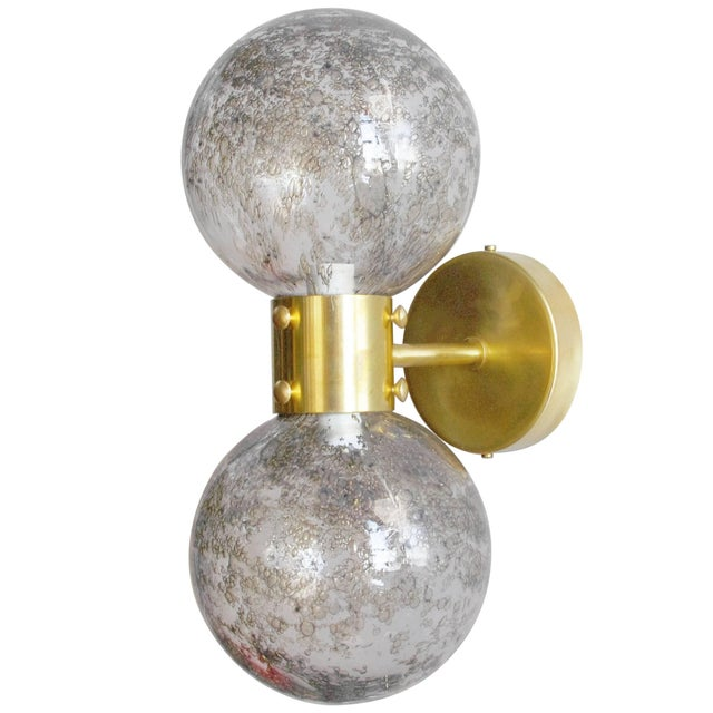 Limited edition Italian wall lights with vintage clear Murano glass globes with smoky bubbles within the glass, mounted on...