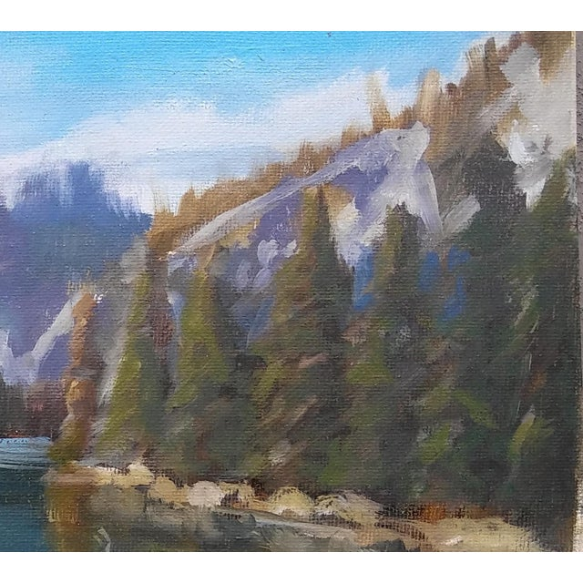 A serene scene of a blue lake painted on an archival quality cotton canvas panel by American artist Paula McCarty. Her...