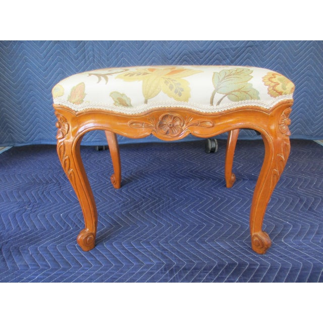 Here's a classic looking French Provincial style footstool with earth tone floral print fabric. The stool is in very good...