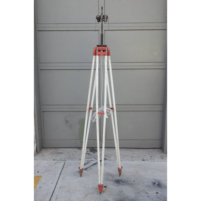 Tall Industrial surveyor tripod floor lamp. Dimensions listed are for the lamp and shade installed. Measures: Shade itself...
