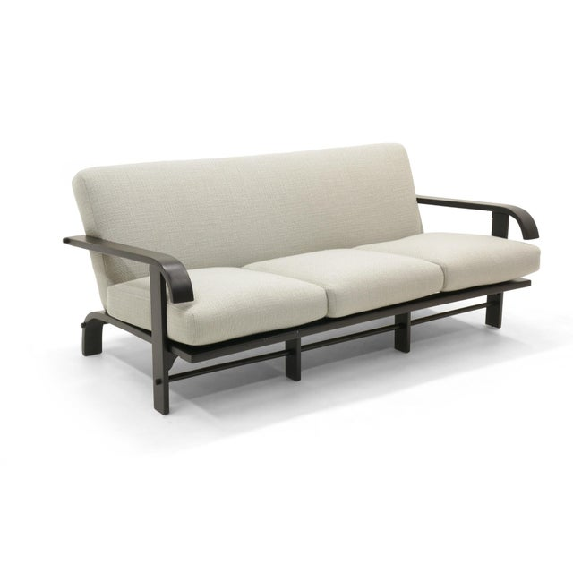 Russel Wright for Conant Ball sofa. Black lacquered wood frame and newly upholstered in a beautiful light grey or sliver...